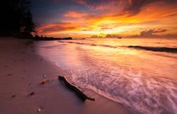 Sunset seascape at Tindakon Dazang Kudat Sabah Malaysia. Image contain soft focus and blur.