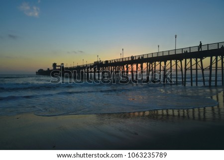 Sunset seascape with panoramic view of Oceanside Pier in San Diego Southern California, one of the longest wooden piers on the West Coast. #1063235789
