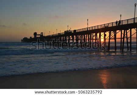 Sunset seascape with panoramic view of Oceanside Pier in San Diego Southern California, one of the longest wooden piers on the West Coast. #1063235792