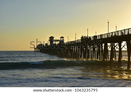 Sunset seascape with panoramic view of Oceanside Pier in San Diego Southern California, one of the longest wooden piers on the West Coast. #1063235795