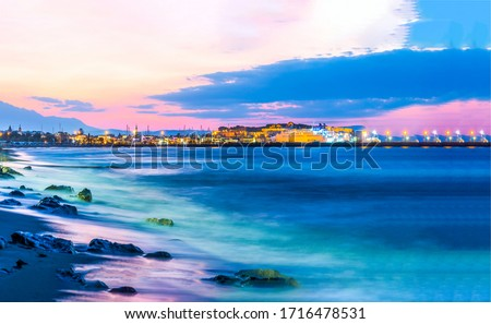 Sunset seashore city lights view