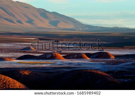 Sunset shadows in the landscape. Tolar Grande, Salta, Argentina. Stock fotó ©