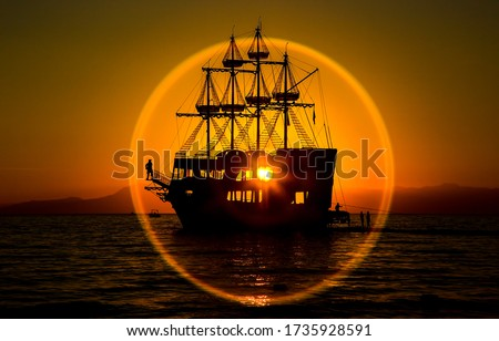 Sunset ship silhouette in circle of sun. Sunset ship silhouette view. Sunset ship view