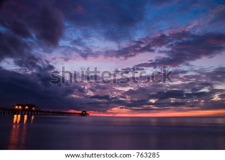 Sunset shot from Naples Florida with the pier.  The sun has already set, and shot captures the remaining reds.  Landscape shot with mostly sky.