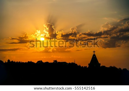 Sunset silhouette of church cross at sunset #555142516
