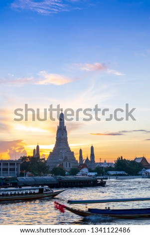 Sunset silhouette of Wat Arun (Temple of Dawn) is the famous landmark landmark of Attractions's Popular tourists, in Chao Phraya river, bangkok Thailand  #1341122486