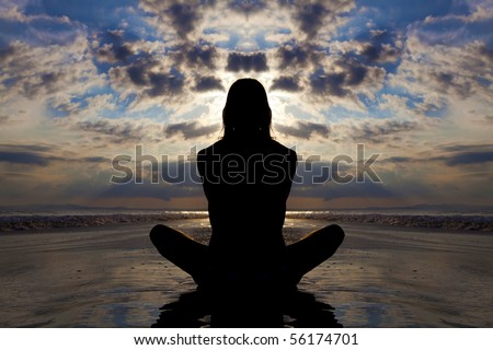 Sunset silhouette of woman doing yoga on the beach.