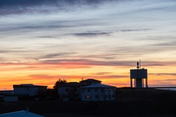 Sunset silhuette of town of Hofn in south Iceland