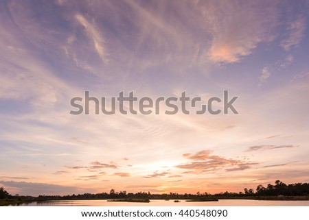 Sunset sky background with landscape of calm lake at sunset  #440548090