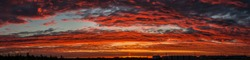 Sunset sky clouds at dusk panoramic view