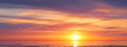 Sunset sky clouds background. Beautiful landscape with clouds and orange sun on sky. High quality photo