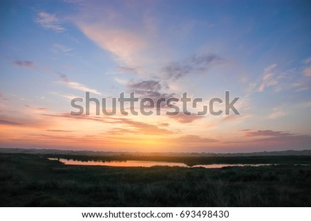 Sunset sky clouds.Countryside Landscape Under Scenic Colorful Sky At Sunset Dawn Sunrise. Sun Over Skyline, Horizon. Warm Colours. #693498430