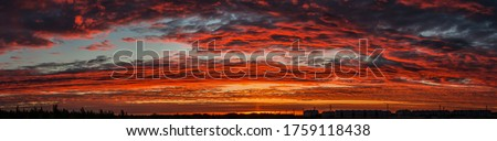 Sunset sky clouds panorama. Sunset sky clouds panoramic landscape. Panorama of sunset cloudy sky