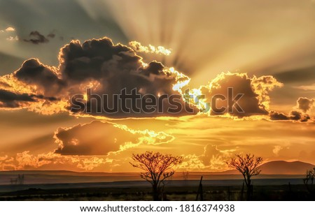 Sunset sky clouds view. Cloudy sky sunset scene. Sunset sky clouds landscape. Sunset sky clouds