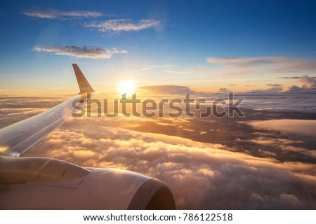 Sunset sky on airplane, plane window, over Copenhagen, Denmark, Scandinavia, Europe in Friday evening flight for relax in holiday #786122518