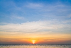 Sunset Sky over sea in the Morning with colorful Sunrise Cloudy, Horizon sky background .