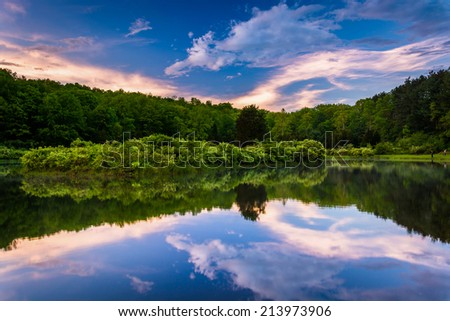 Sunset sky reflecting in a pond at Delaware Water Gap National Recreational Area, New Jersey.