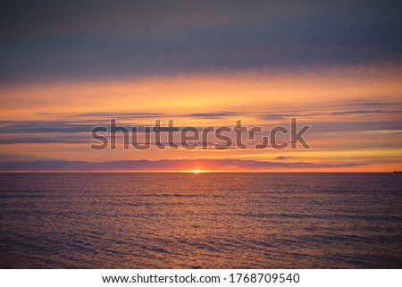Sunset sky reflecting in the water, aerial view from the sandy shore. Setting sun. Abstract art, natural pattern. Baltic sea, Sweden. Idyllic seascape. Travel destinations, vacations concept Photo stock ©