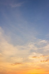 Sunset sky vertical with colorful sunlight clouds background.