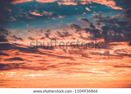 sunset sky with lighted beautiful clouds