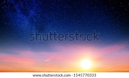 Sunset sky with orange setting sun and red clouds landscape against bright star on black universe background. Wide panorama view of stars in space nature at dark time. Starry night at night wallpaper Foto d'archivio ©