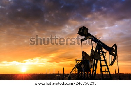 Sunset sky with profiled oil well Stockfoto ©