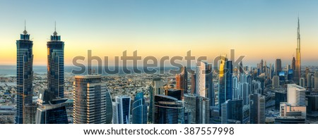 Sunset skyline with modern skyscrapers in Dubai, UAE. Aerial  view of business bay\'s architecture.