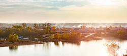 Sunset summer panorama on the Ufimka River from the opposite shore.