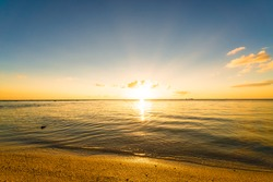 Sunset, sunbeam, sky, sea, beach. Okinawa, Japan, Asia.