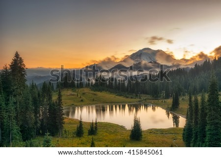Sunset/sunrise, a famous mountain in America, tree, forest, and lake, Mt. Rainier National Park, USA