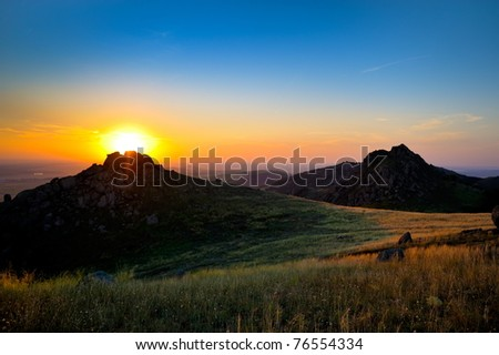 sunset/sunrise over the field