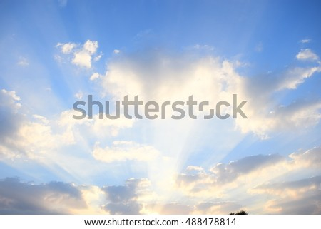 Sunset / sunrise with clouds, light rays and other atmospheric effect #488478814