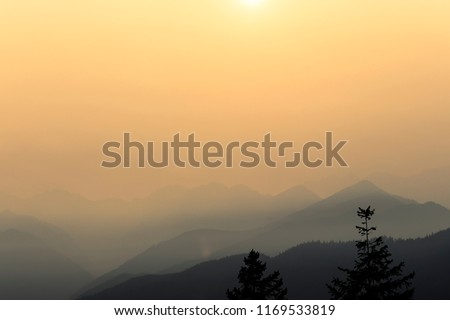 Sunset through the haze of smoke from wildfires in the western United States