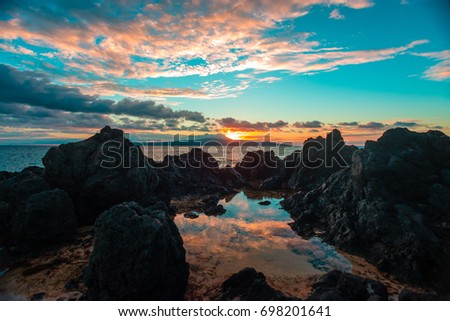 Sunset tidepool reflection #698201641