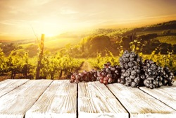 Sunset time and fresh grapes fruits on wooden desk place