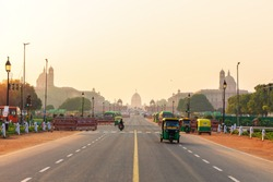 Sunset traffic in New Delhi, India, tuc tuc cars on the road to the Presidential Residance