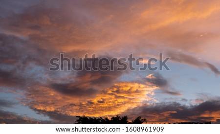 Sunset Twilight orange sky see the beautiful purple nature a plane background. Sunset Twilight orange sky see the beautiful purple nature plane background