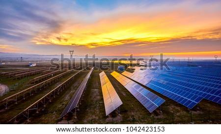 Sunset under new energy solar photovoltaic #1042423153