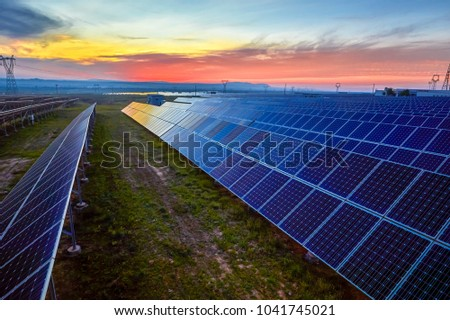 Sunset under the solar photovoltaic #1041745021