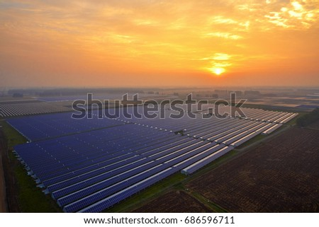 Sunset under the solar photovoltaic panels #686596711