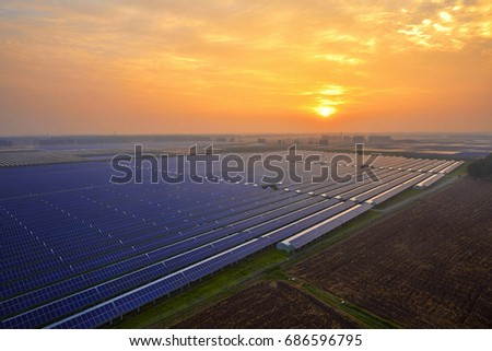 Sunset under the solar photovoltaic panels #686596795