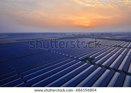 Sunset under the solar photovoltaic panels #686596804