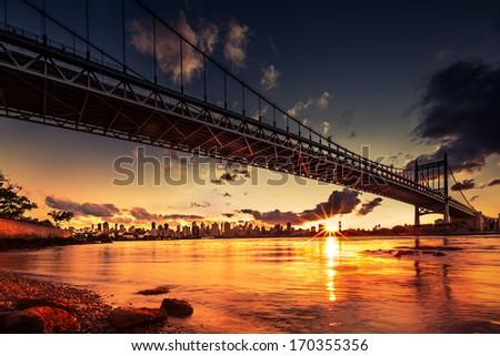 Sunset under Triboro bridge Stock fotó ©