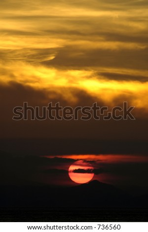 sunset under yellow clouds