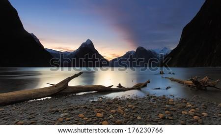 Sunset view at Milford Sound lakeside, with Mitre Peak mountain on the back. Located in South Island of New Zealand.