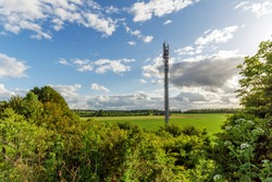 Sunset view British Mobile Operator Mast over field