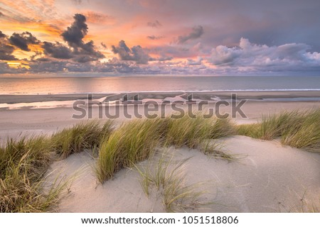 Sunset View from dune top over North Sea and Canal in Zeeland, Netherlands #1051518806