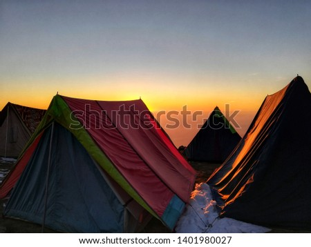 Sunset view from the top of Triund Trek with our tents and snow. it was month of January when the snowfall started and at the day of this pic the snowfall just ended so the air was quiet.