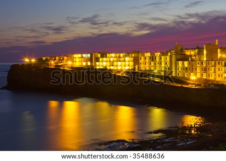Sunset view of a beach with reflexes in the sea of Lanzarote island