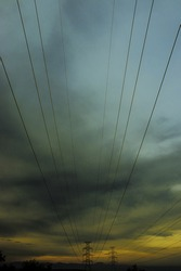 Sunset view of a high-voltage electricity power supply in Negros Oriental, Philippines.